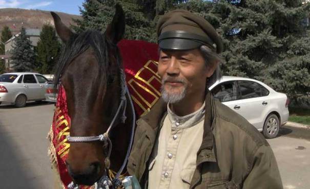 g Li is making his third journey mounted on a Karachay stallion donated by Khasan Kilichbievich Salpagarov, a distinguished breeder.