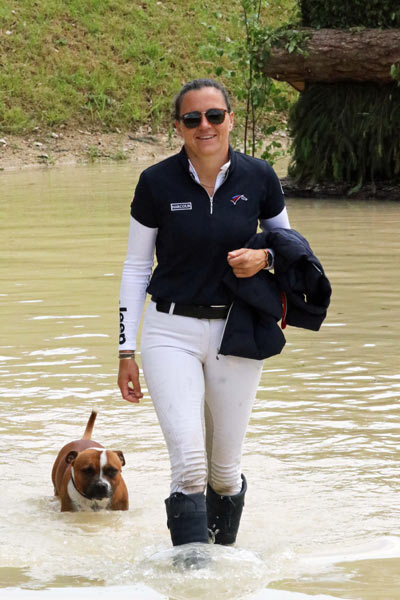 Gwendolen Fer's dog Marcel enjoys a paddle during the CIC3* course walk at Bramham.