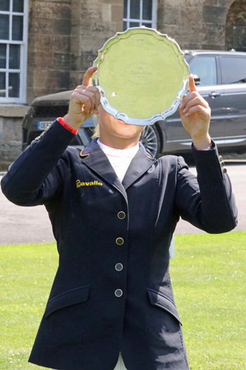 Julia Krajewski enjoys the spoils from theBramham CCI3* Horse Trials.