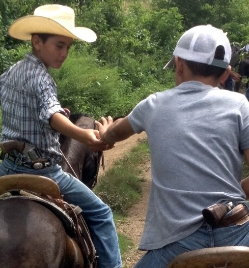 While riding in Honduras Filipe witnessed the pervasive violence that is threatening to destroy civilization in Latin America. These children were armed with .45 caliber revolvers while accompanying the Long Rider through a portion of their country.