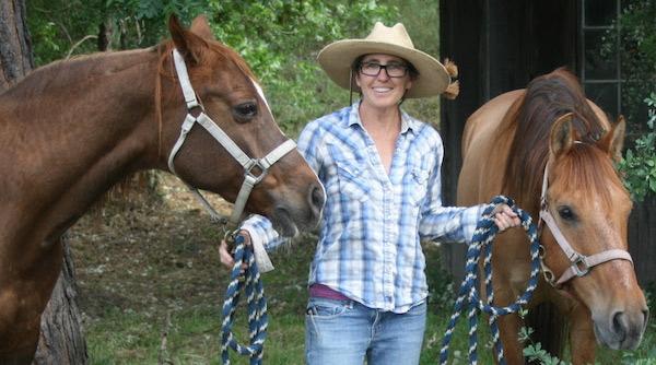 Celeste Carlisle with her horses, Tishka, left, and Sammy.