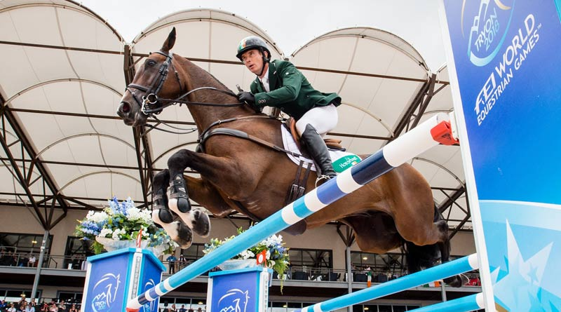 Padraig McCarthy and Mr Chunky on their way to a clear round to seal the individual silver medal. © Erin Gilmore