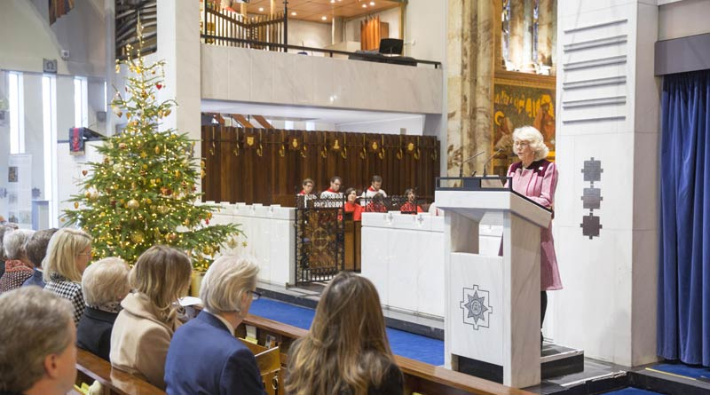 Camilla, the Duchess of Cornwall, gives a reading at Brooke's first ever carol service last Wednesday.