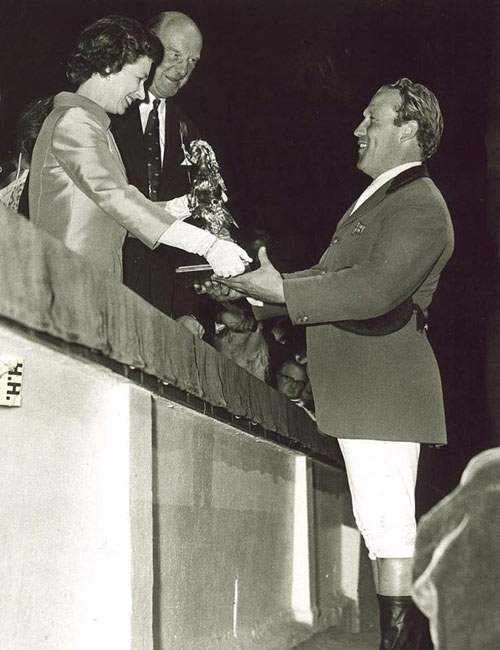 Ted Edgar being presented with his trophy by Queen Elizabeth II after a win at Hickstead.