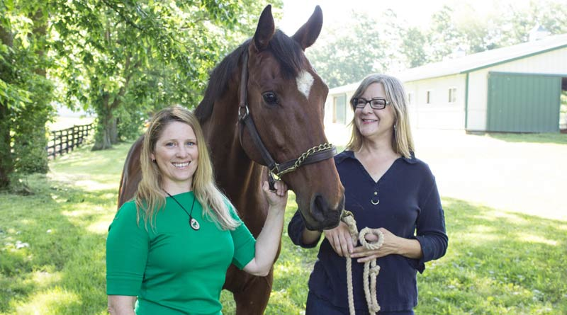 Researchers Karin Pekarchik, left, and Kimberly Tumlin are seeking information on those who participate in horse sports to learn more about the socioeconomic factors about the industry.© Hilary Brown, UK Photo