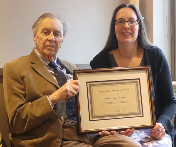 Gordon Wesley being presented with the Sir Colin Spedding Award Certificate by NEF Administrator Dr Georgina Crossman.
