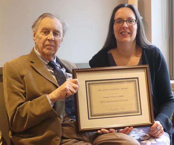 GordonWesleybeing presented with the Sir Colin SpeddingAwardCertificate by NEFAdministrator Dr Georgina Crossman.