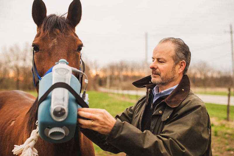 Laurent Couëtil uses an equine nebulizer to administer treatment for asthma.