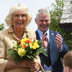 Jacob Leney, sings an impromptu Happy Birthday to the Duchess of Cornwall during her visit to The Donkey Sanctuary in Devon on Wednesday. © The Donkey Sanctuary