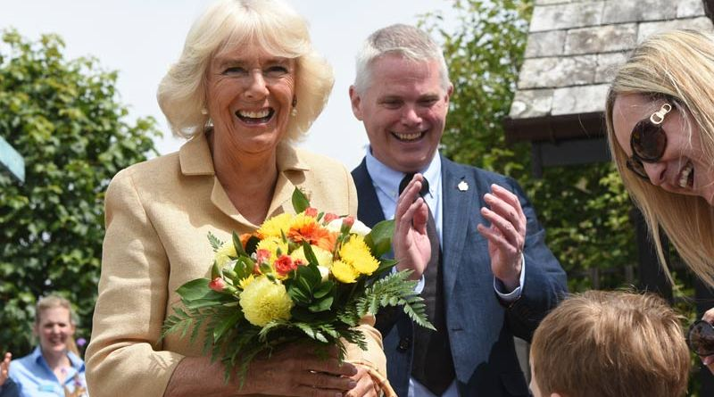 Jacob Leney, sings an impromptu Happy Birthday to the Duchess of Cornwall during her visit to The Donkey Sanctuary in Devon on Wednesday.