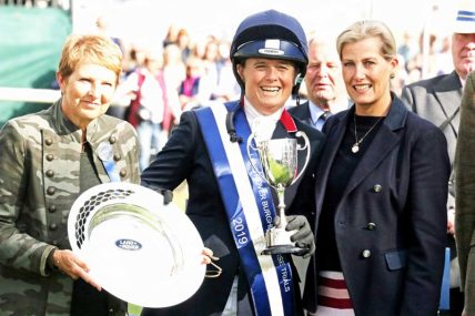 Burghley winner Pippa Funnell receives her price from Sophie, Countess of Wessex.
