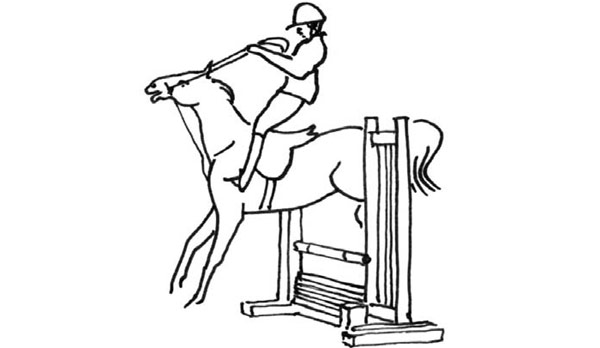 A show jumper balancing herself by using the reins at the horse's expense.
