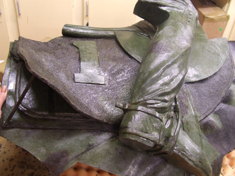 Jim Pike's leg in wax after being refinished by Joanne Sullivan-Gessler. The wax saddle cloth beneath is still rough and awaiting her attention.