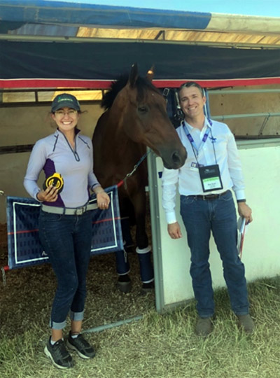 Shannon Wood measuring horses at 2018 Rebecca Farm, with Cambalda and United States Eventing Association CEO Rob Burk.