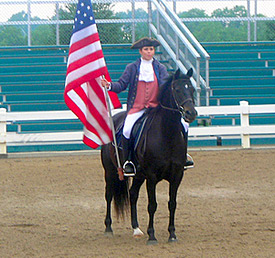A Morgan horse and rider in colonial attire at a Parade of Breeds at the Kentucky Horse Park. The costume is intended to resemble Justin Morgan and Figure. Kentucky Horse Park.