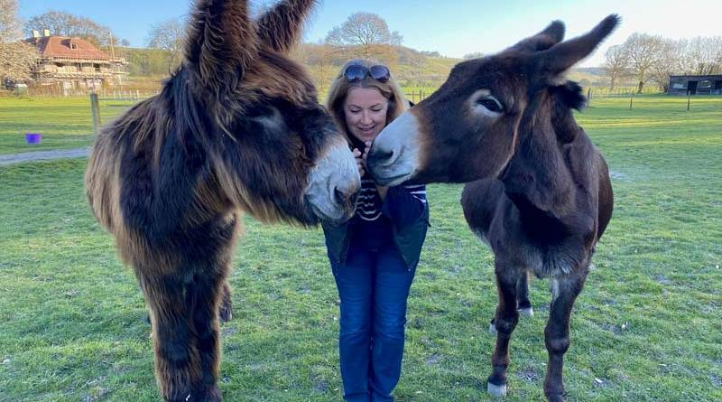 Topper and Dolly with Sarah-Jane Newton. The two donkeys have become inseparable.