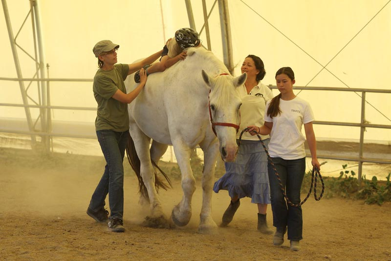 A young rider in a therapy session.