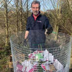David Booth of Westgate Labs works on composting the pouches. The material is being used for new tree planting on a 73-acre nature reserve on reclaimed open-cast land. © Westgate Labs