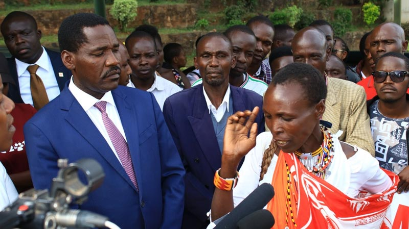Kenya's agriculture minister Peter Munya listens to the concerns of a donkey owner.