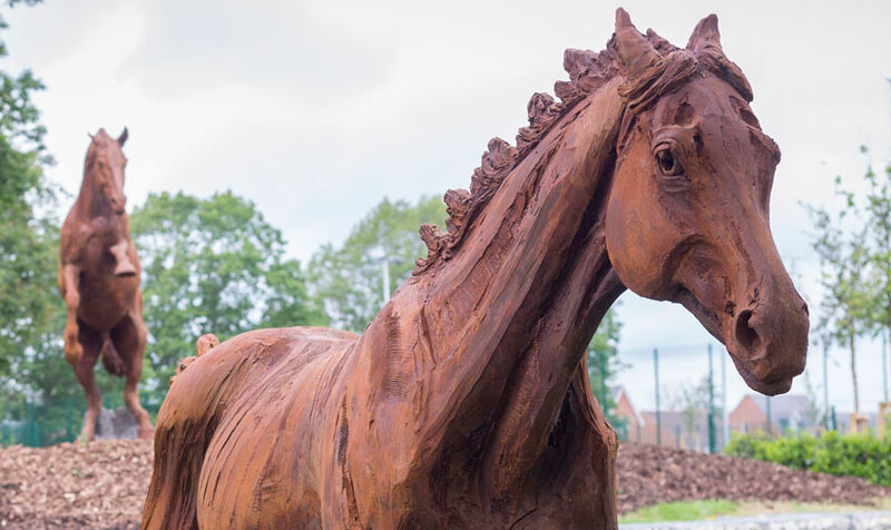 Detail of Youngster, one of the three statues by Amy Goodman at the Arborfield Green development near Wokingham in Britain.