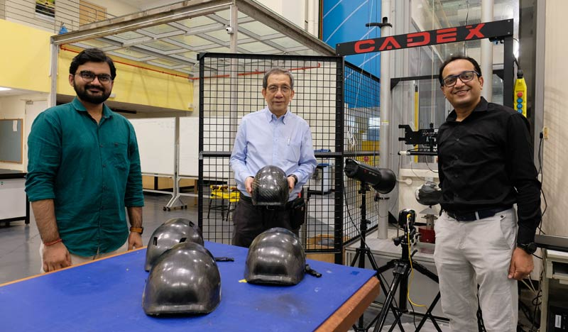 From left, Research associate Goram Gohel, Associate Professor Leong Kah Fai and research fellow Dr Bhudolia Somen Kumar, from NTU's School of Mechanical and Aerospace Engineering, with their composite bicycle helmet prototype.
