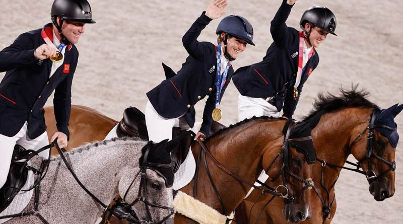 The victorious British Tokyo 2020 eventing team gold medalists Oliver Townend, Laura Collett and Tom McEwen.