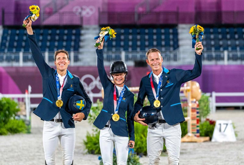 The victorious Swedish showjumping team, from left, Henrik von Eckermann (King Edward), Malin Baryard-Johnsson (Indiana) and Peder Fredricson (All In) after winning gold at Tokyo 2020.