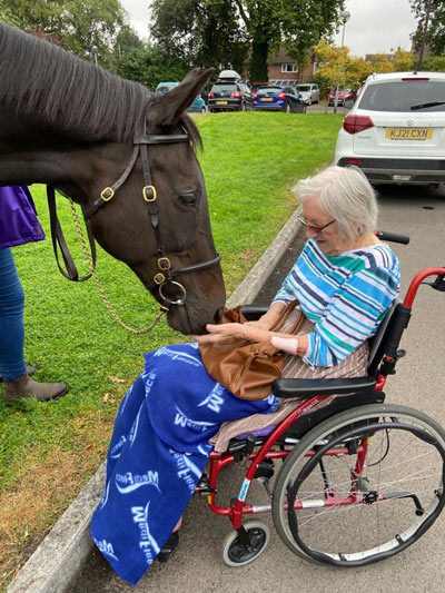 Ouzbeck spends time with one of the residents of the OSJCT Coombe End Court care home in Marlborough.