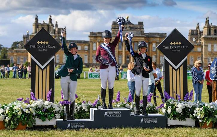 From left, Susie Berry (3rd), Yasmin Ingham (1st), and Ros Canter (2nd) on the CCI4*-L podium at the Blenheim Palace International Horse Trials.