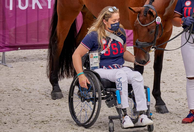 US Paralympic rider Beatrice De Lavalette shares a moment with her horse, Clarc. They finished fifth in the Grade II Individual Test, and sixth in the G2 Freestyle. De Lavalette lost both of her lower legs in the 2016 bombing at the Brussels Airport.