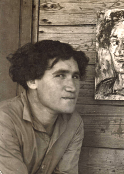 Artist Chaim Atar with his self portrait, Ein Harod, late1930s