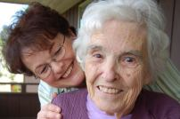 smiling caregiver and patient