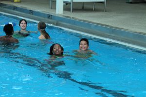 Children swimming during Pathways Breakaway event.