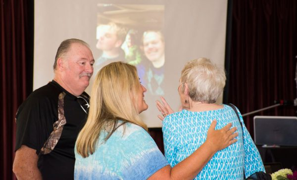 Mary and friends enjoy looking at a slideshow of her favorite memories at her Big A-Wake.