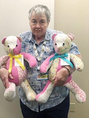 Volunteer Holding Handmade Bears