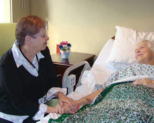 Volunteer Visiting A Patient