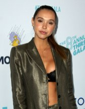 Alexis Ren cleavagy wearing bra and jacket at 8th Annual Thirst Gala in Beverly Hills