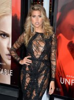 Kara Del Toro show off her breasts in deep cleavage