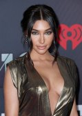 Chantel Jeffries looks sexy wearing low-cut gold dress showing off her boobs