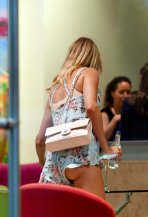 Kimberley Garner having wardrobe malfunction wearing short dress exposing her bare ass