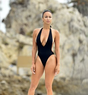 Draya Michele - Rocking a sexy black maillot from her Mint Swim collection on Newport Beach