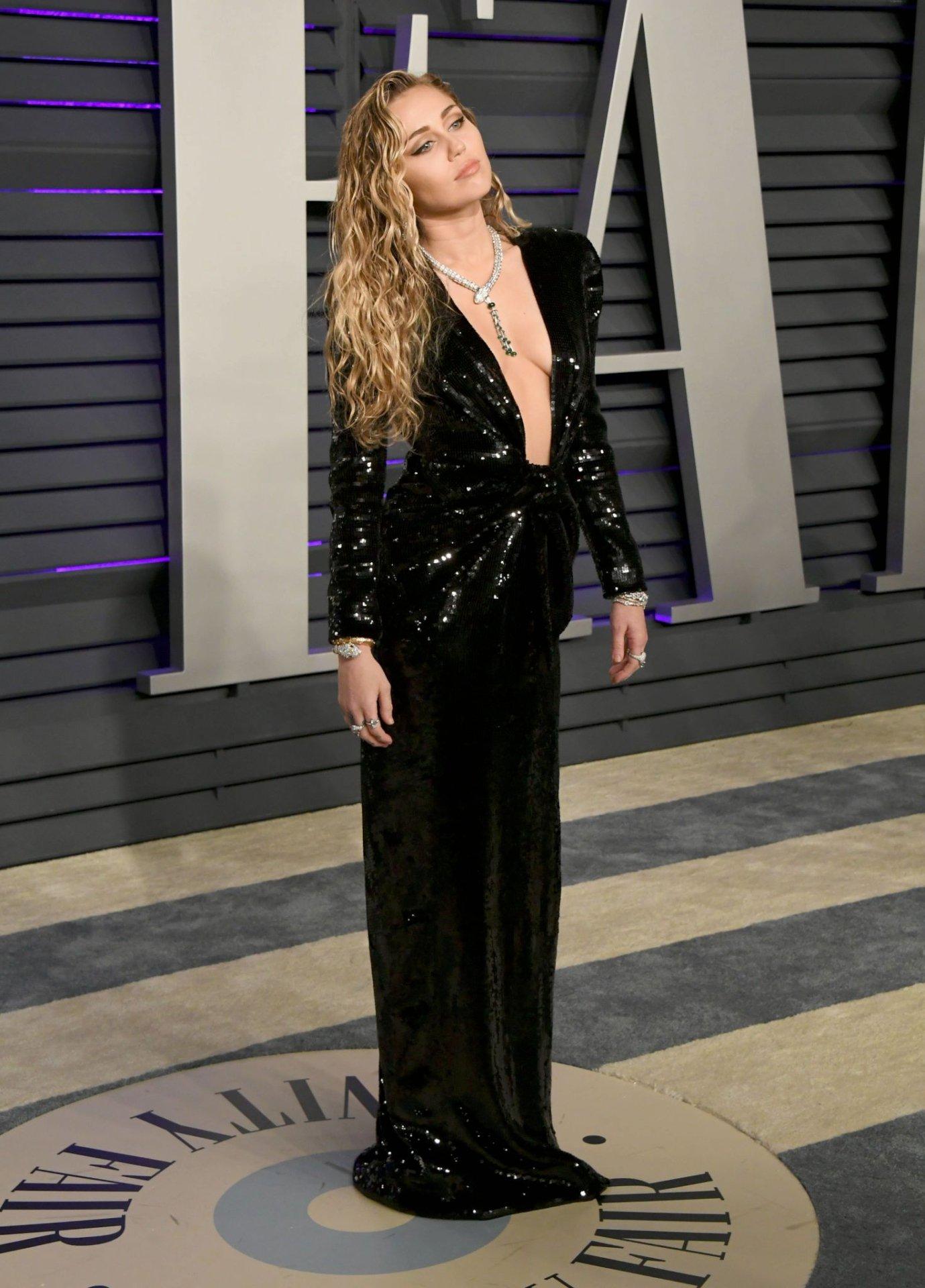 Miley Cyrus Sexy Braless Dress