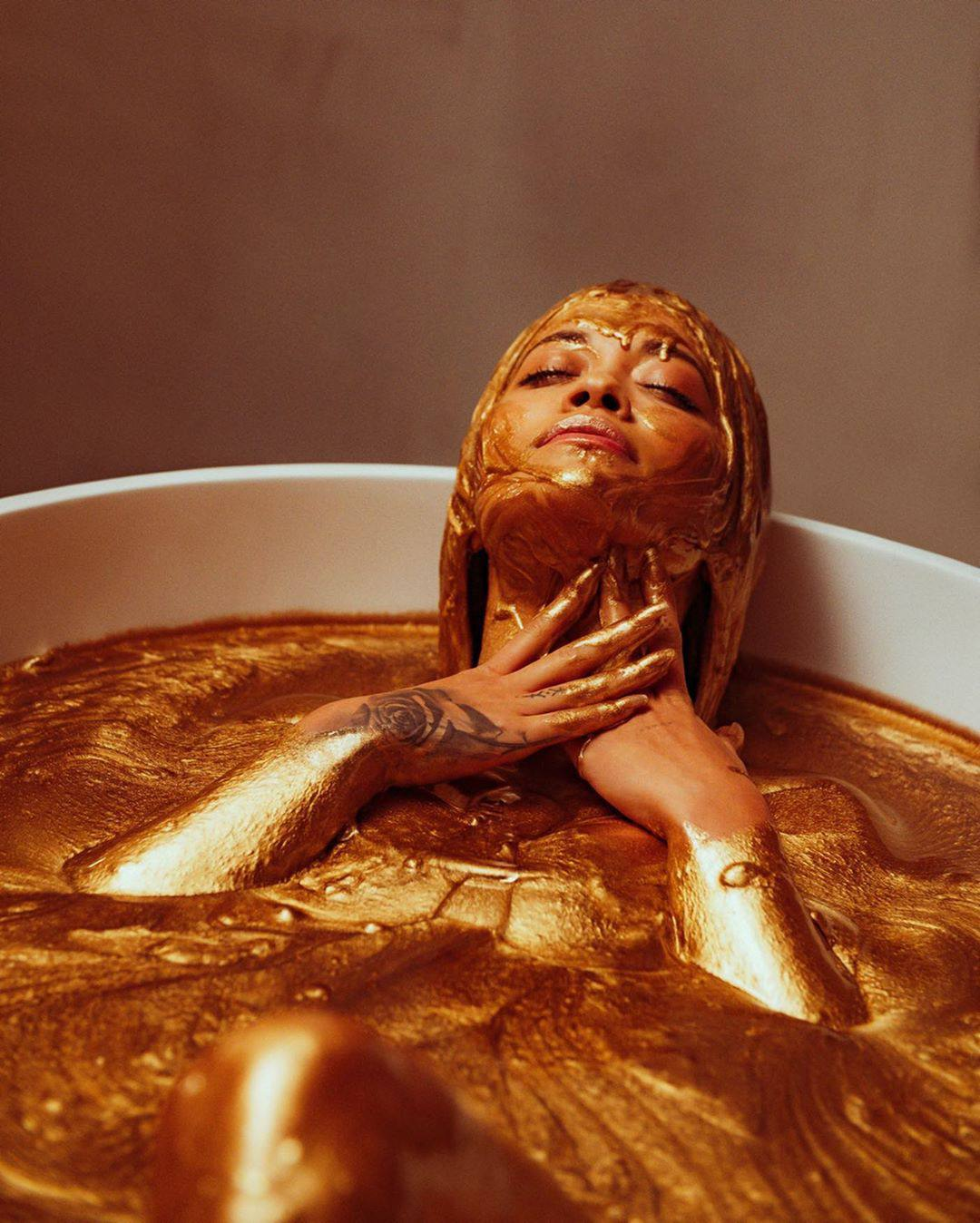 Rita Ora Sexy In Gold Bath
