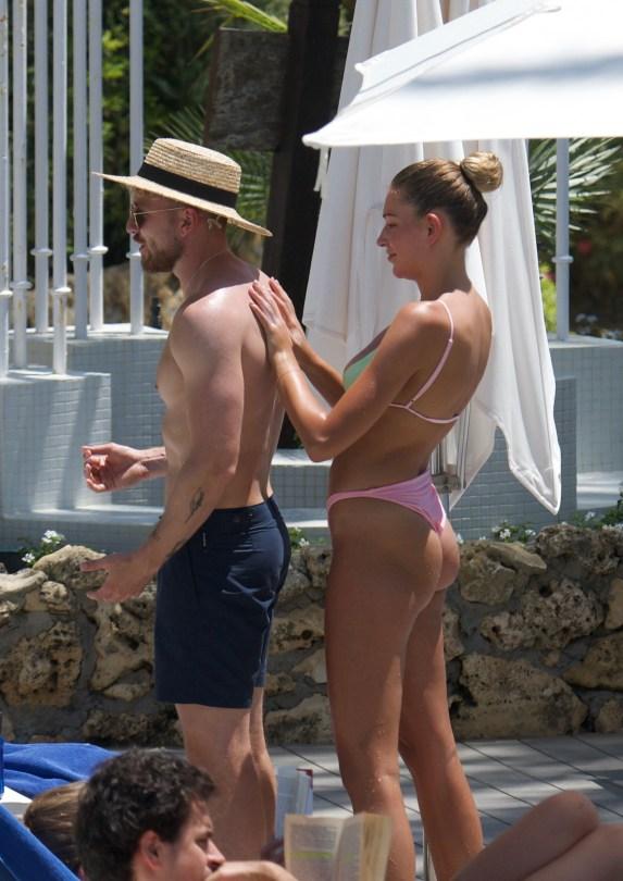 Exclusive: Zara Mcdermott Shows Off Her Sensational Bikini Body As She Chills In A Hotel Pool In Marbella.