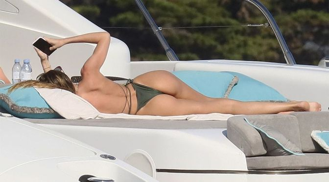 Candice Swanepoel – Beautiful Ass in a Thong Bikini on a Yacht in the French Riviera