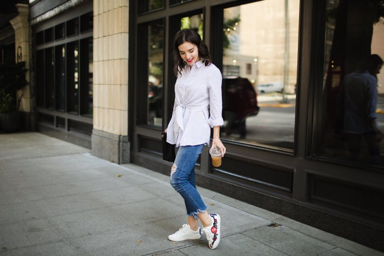 Striped collared button up blouse and embroidered white sneakers