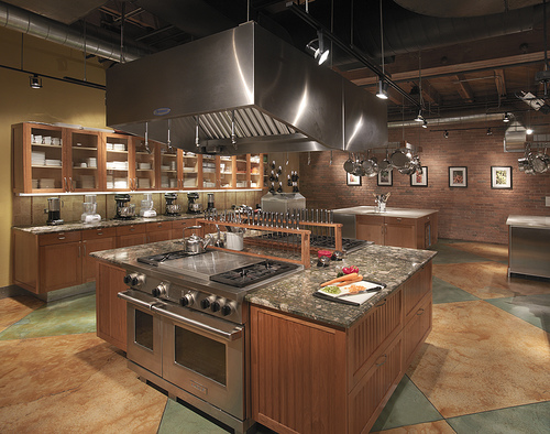Brown kitchens color provides warmth and comfort equipped with the peninsula