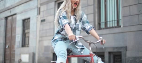 happy cycling woman