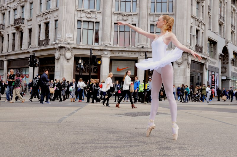 A ballerina holds her pose in London's Oxford Circus.