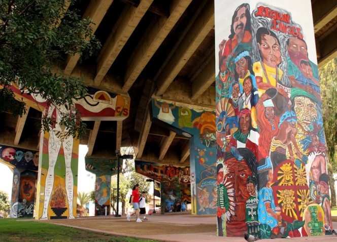 Murals under the highway during the daytime at Chicano Park in Barrio Logan, San Diego.